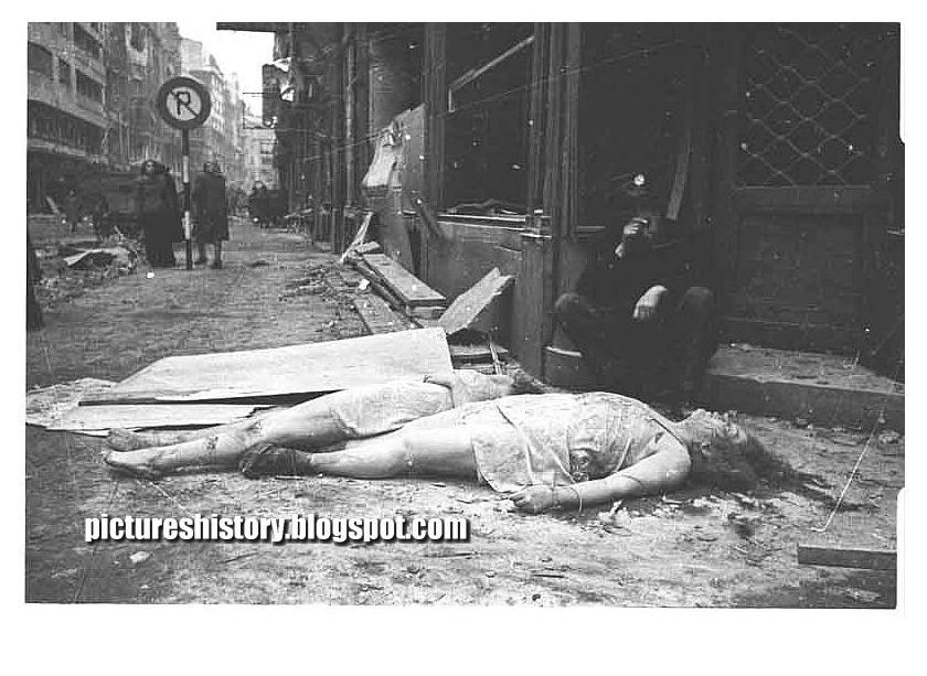 German women lie dead on a street in berlin in 1945 after they were