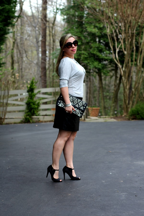 Faux Leather Skirt- Forever 21, Top and Studded Black Clutch - TJ Maxx, Black Pumps - Nordstrom Rack, Baroque Round Sunglasses - Prada, Punk Metal Necklace - Nordstrom, Silver and Black Onyx Ring - David Yurman