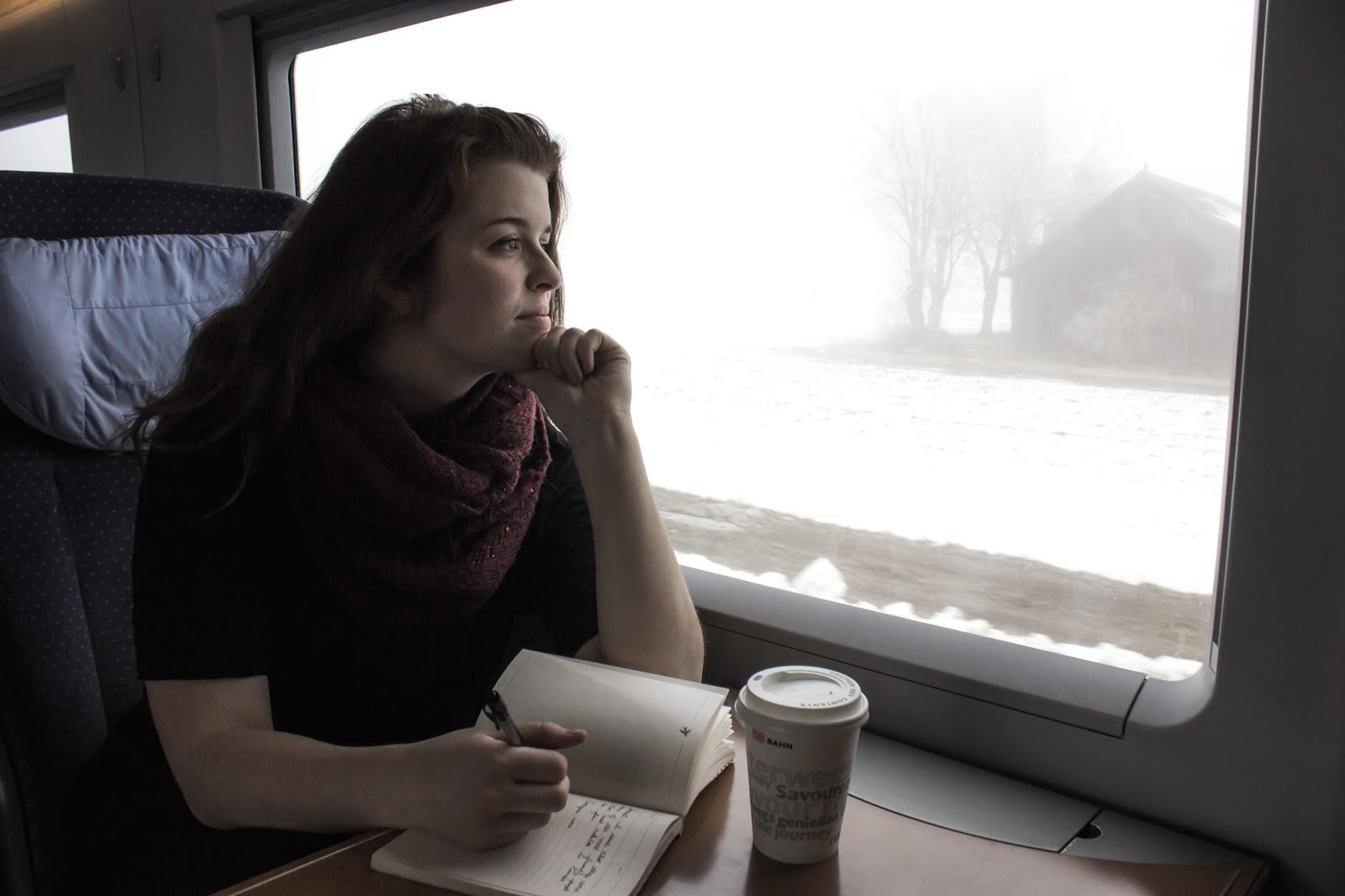 girl writing on train
