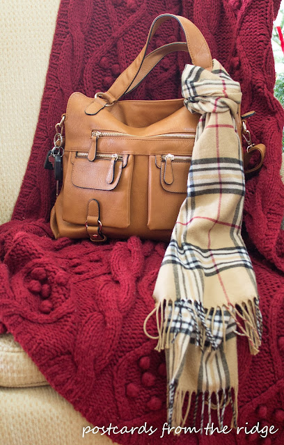Plaid scarf on a designer camera bag