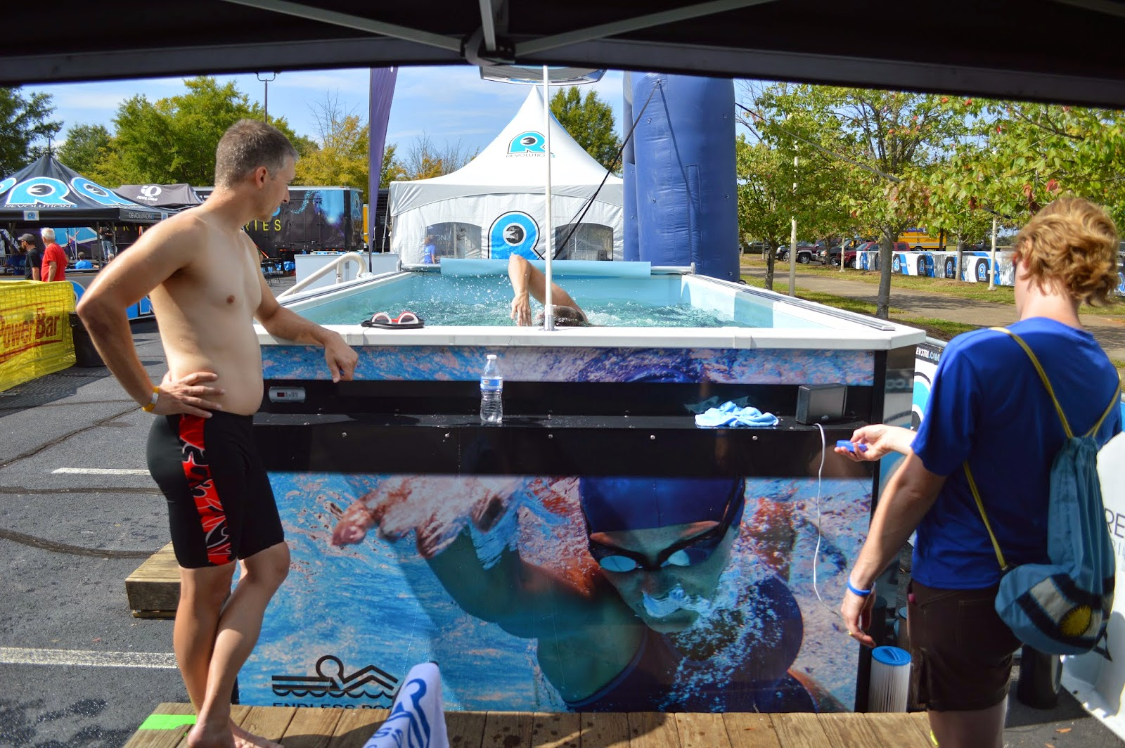 Onlookers watch a test-swimmer in the Endless Pool at the REV3 triathlon Expo in Anderson, SC, on October 11, 2014.