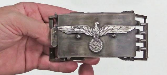 http://foxtrotalpha.jalopnik.com/this-steampunkish-nazi-belt-buckle-pistol-packs-a-deadl-1629715089