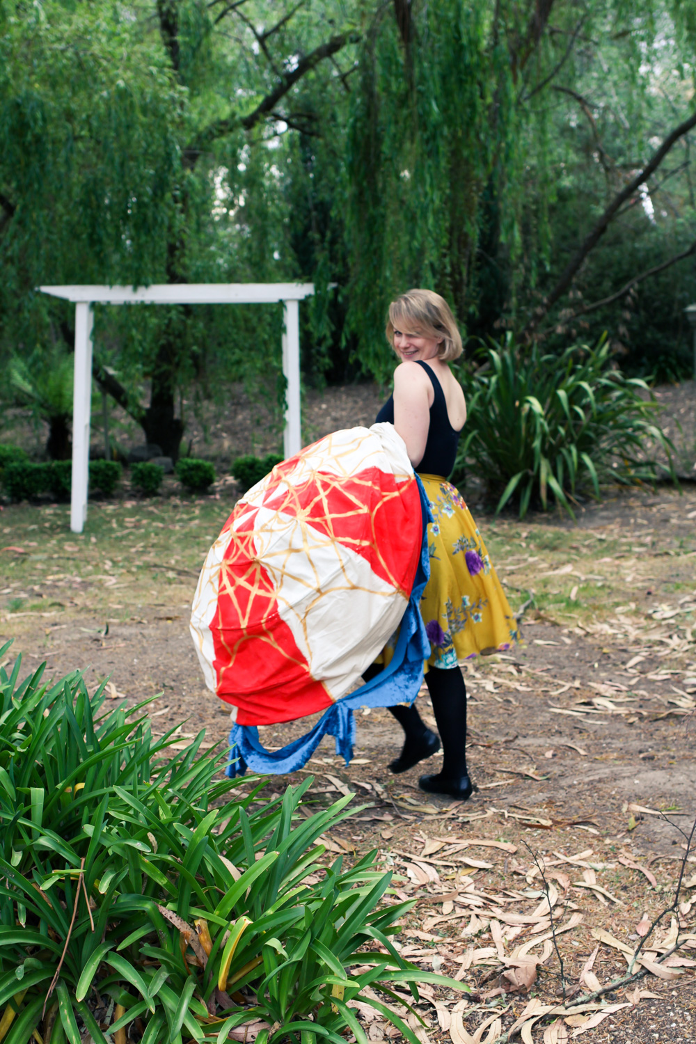 Liana of Finding Femme with a hot air balloon halloween costume, including tips for making one yourself.