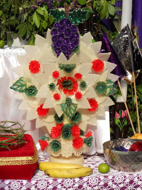 Traditional Mexican candle with handmade wax ornaments shaped like petals, leaves and flowers