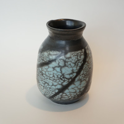 Beautiful colored naked raku pottery vase by Lily.