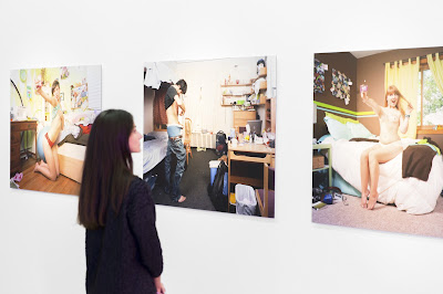 Photo of woman looking at the photos from Evan Baden's series Technically Intimate at NRW-Forum Düsseldorf