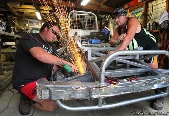 L-R: Brett Loveridge, Hastings, a Meeanee Mauler, with Aussie Holloway, one of his pit crew, preparing his car for this weekend's Peter Barry Memorial Teams Stockcar event. photograph