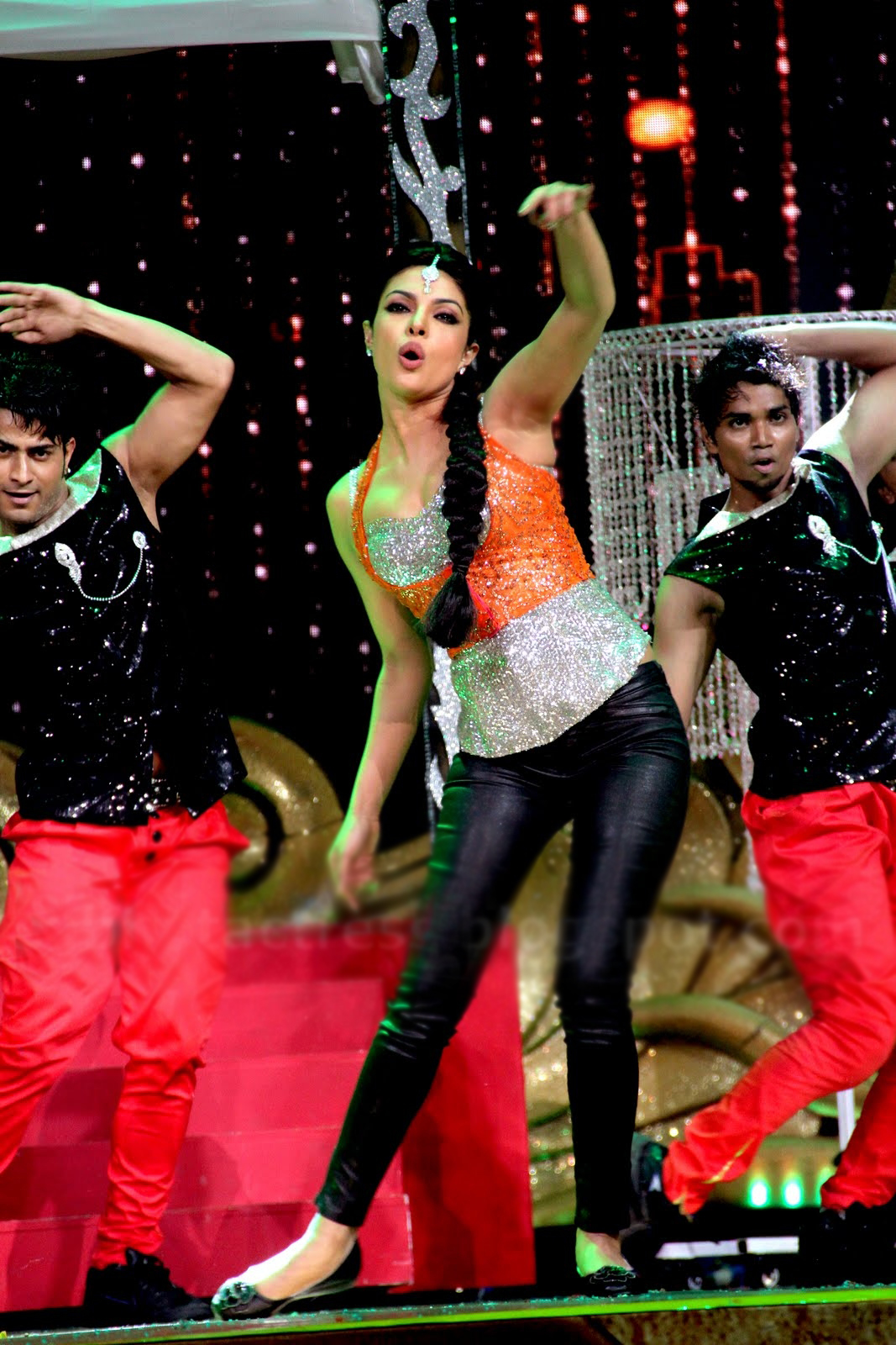 Priyanka dancing in black leather pants with silver top and shining orange vest - (3) - priyanka chopra iifa 2012- on stage !