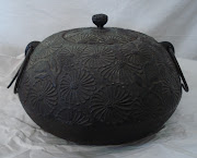 The iron pot is Japanese. Both have wonderful patina. info@ioneta.us