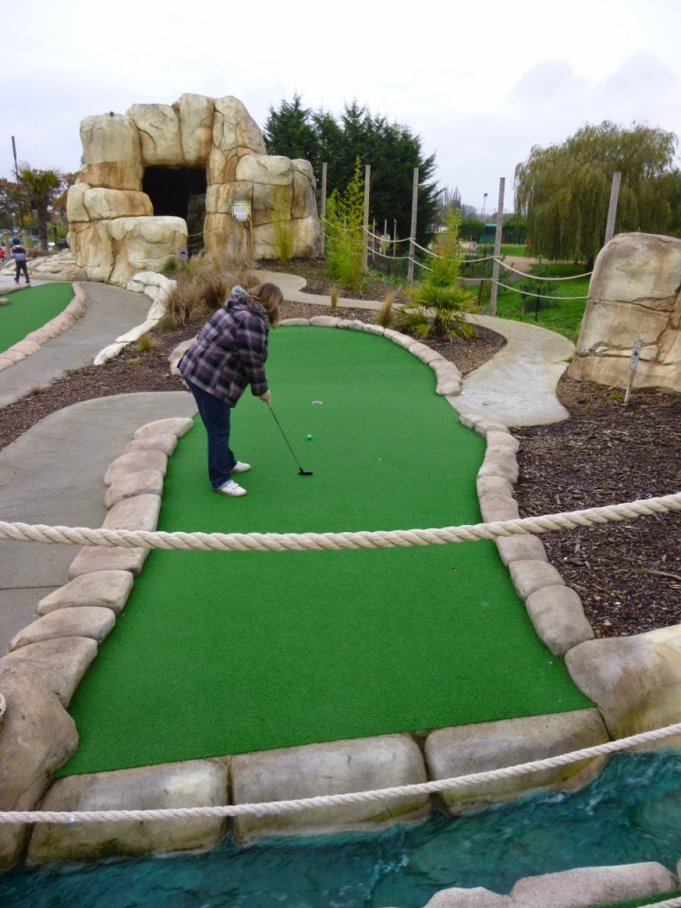 Helen Dodd putting at Jungle Island Adventure Golf course at Horton Park Golf Club in Epsom, Surrey