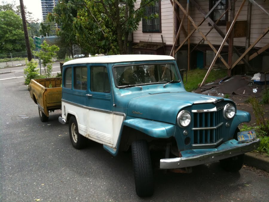 OLD PARKED CARS.: 1960 Willys Jeep Wagon with Trailer.