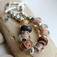 Pandora style bracelet in gold, pink and brown