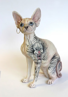 sphynx cat tattoo skin