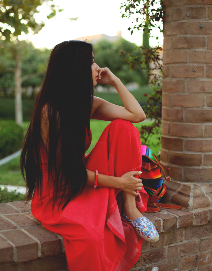 Stephanie Liu of Honey & Silk wearing Armani denim dress (thrifted), tropical Soludos shoes, and Stela 9 hacienda backpack