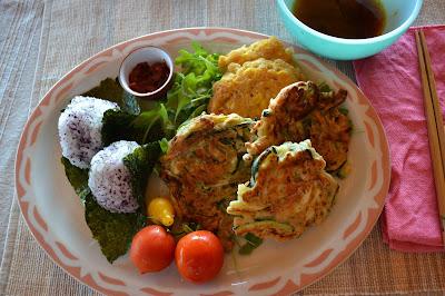 ... , corn buchimgae (Korean style pancakes), rice balls and veggies