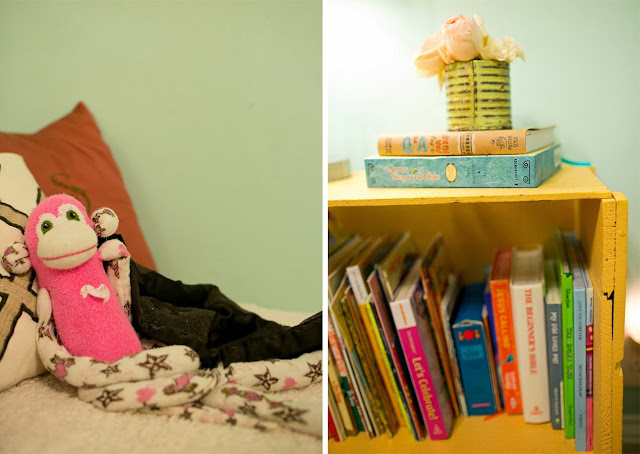 Bright and fun, colorful little girl's room on a budget. Pink sock monkey, antique crates as bookshelves