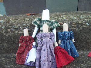 A Family of Rolled Cloth Dolls