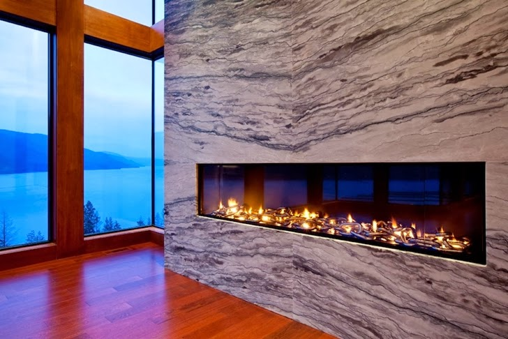 Marble fireplace in Contemporary style lake house in Canada