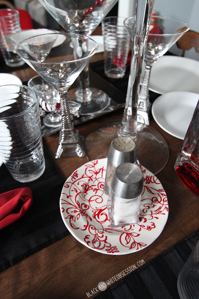 Black and White with a Dash of Red Simple Holiday Tablescape Intricate Plate Salt and Pepper