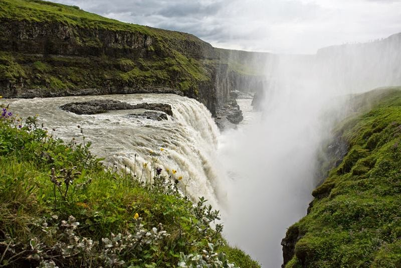 Gullfoss  is a waterfall located in the canyon of Hvítá river in southwest Iceland, Its stands on the edge of the mountain range, from roaring water falls down the rapid river Hvita.