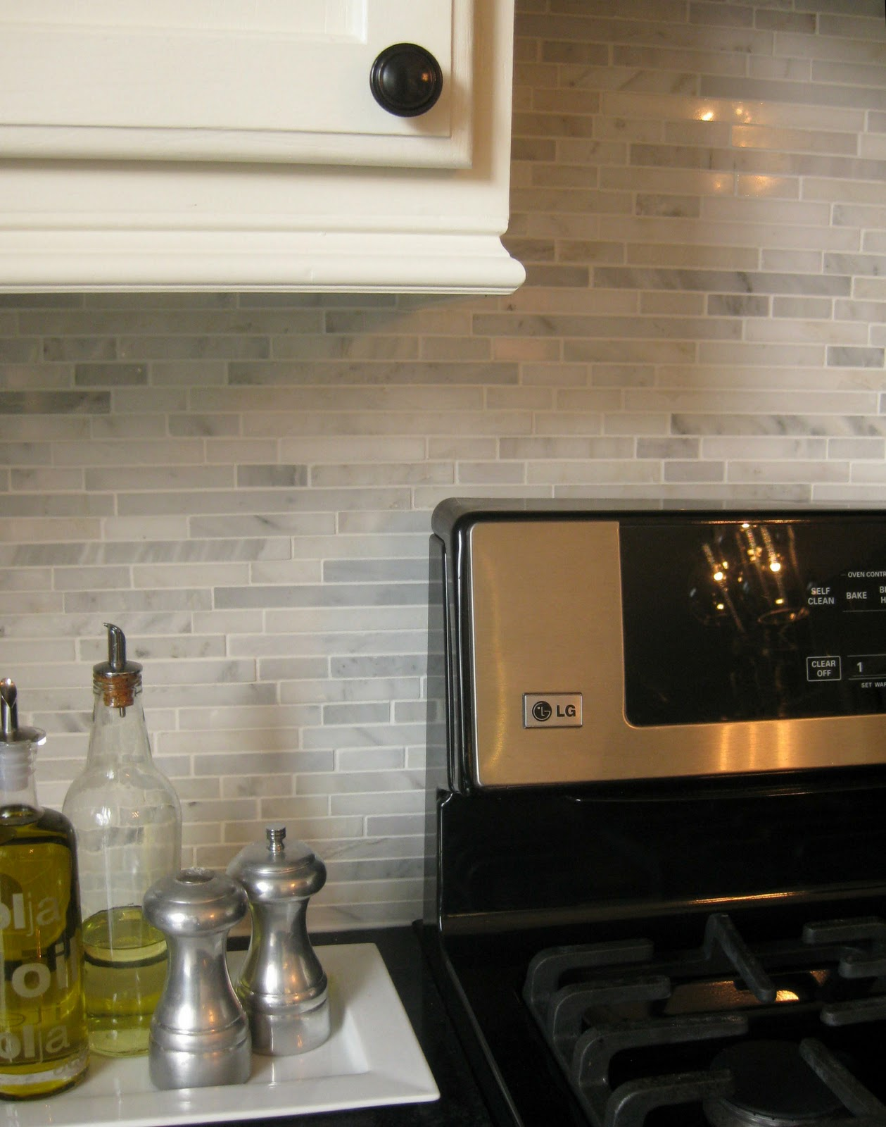 marble backsplash installation behind stove
