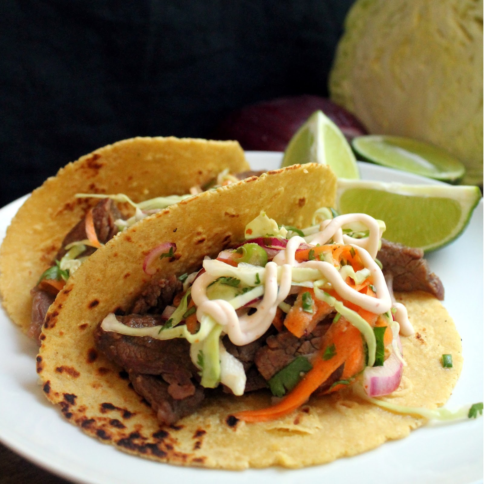 Korean Bulgogi Tacos with Kimchi Slaw and Sriracha Sour Cream
