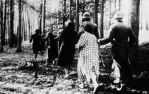 German soldiers march Polish women shot woods