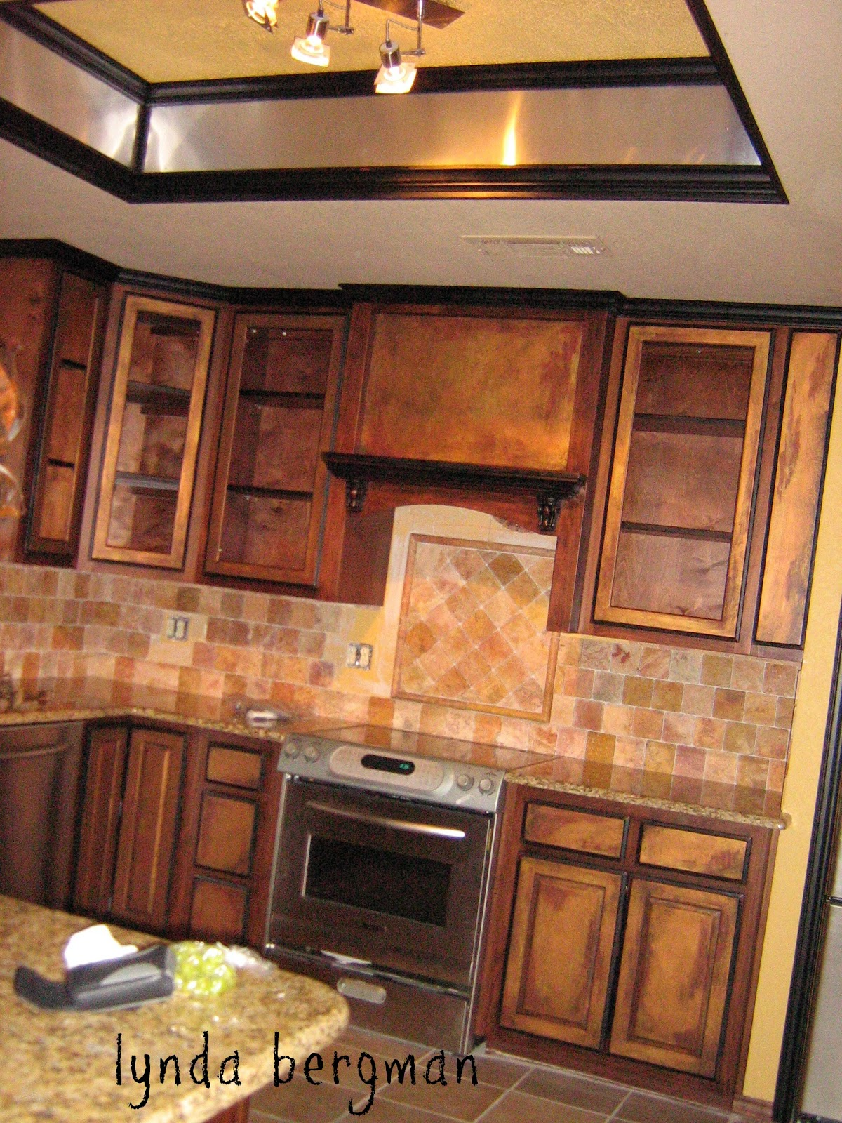 BLACK & AN  ANTIQUE COPPER  SPECIAL FINISH ON KITCHEN CABINETS
