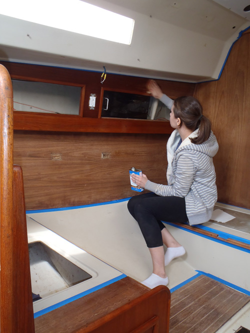 oiling the teak interior of a boat