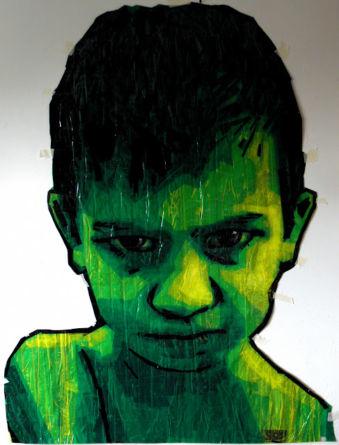 tape-art green artist wall kid face