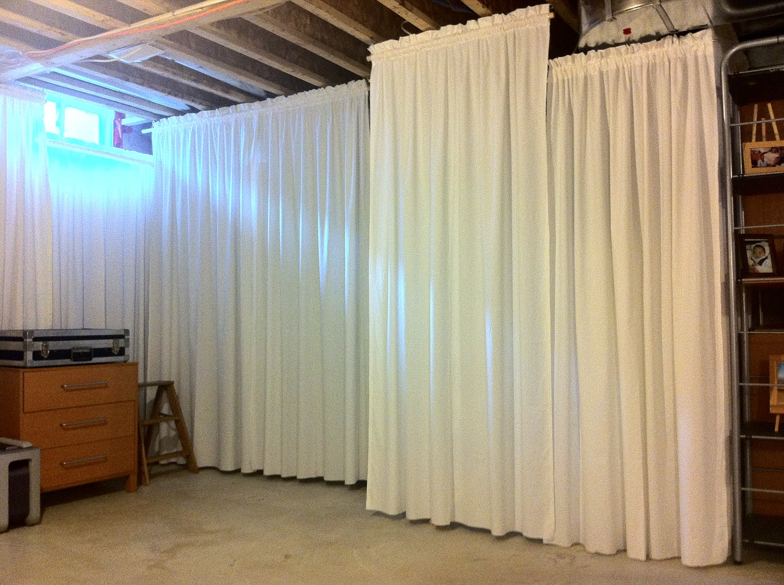 Covering Walls With Curtains : Houseonashoestring unfinished basement main area
