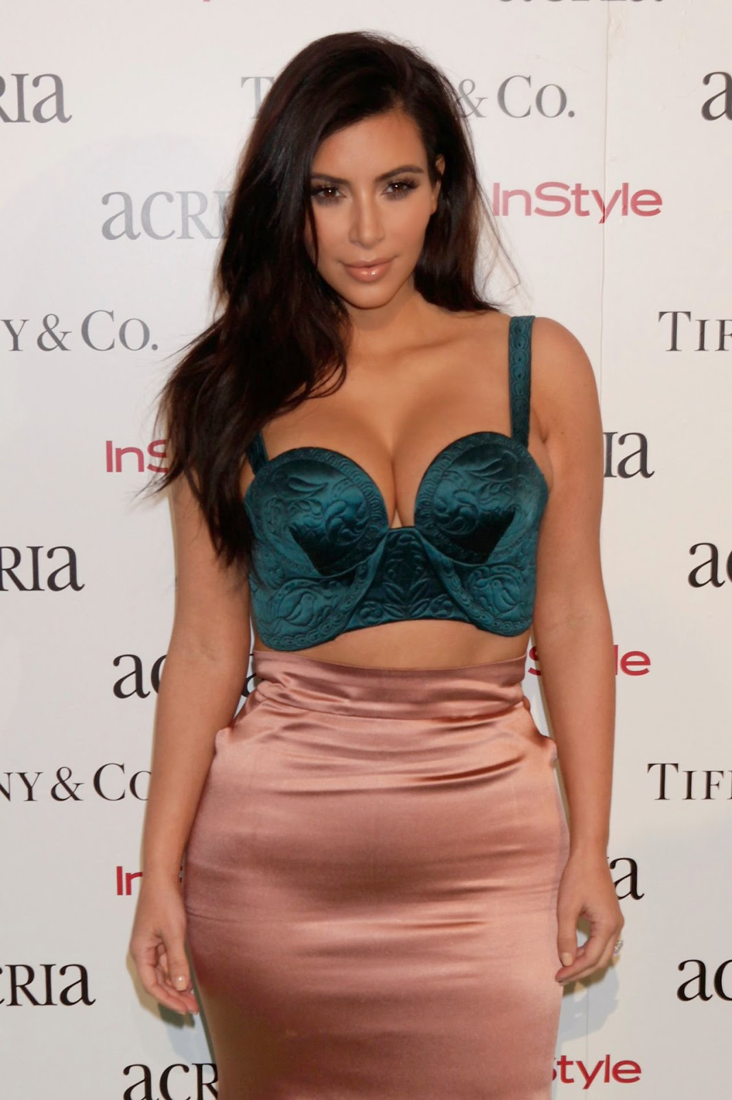 Kim Kardashian wears a bralet and pencil skirt to the 2014 ACRIA Holiday Dinner in NYC