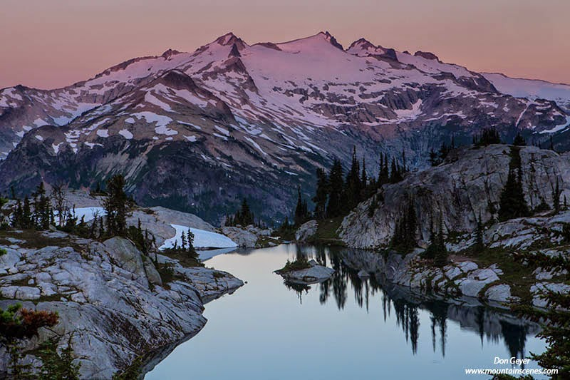 Morning alpenglow on Mount Daniel above Lower Robin Lake in the Alpine Lakes Wilderness, Cascade Range, Washington, USA.