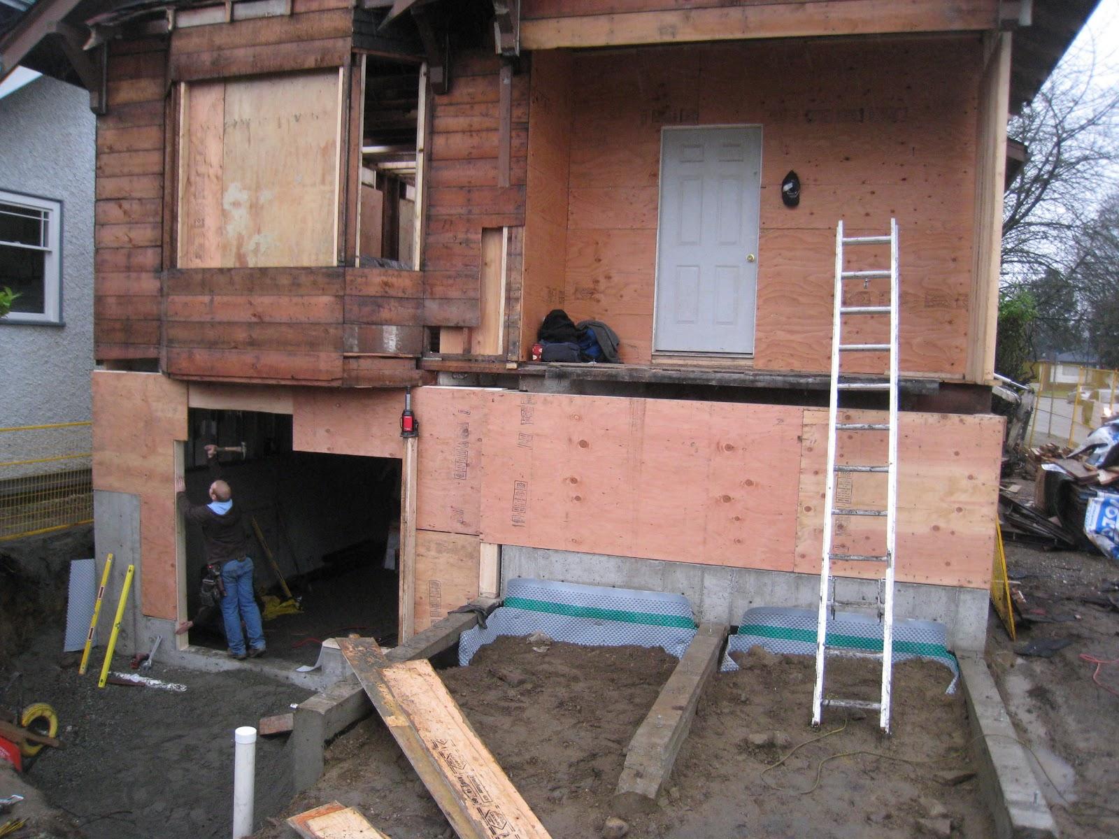 drainage mat installed backfill complete backframing begins