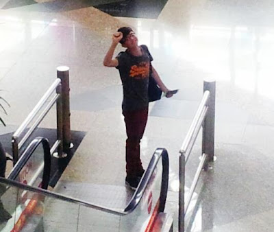 Greyson Chance KL airport wearing new glasses