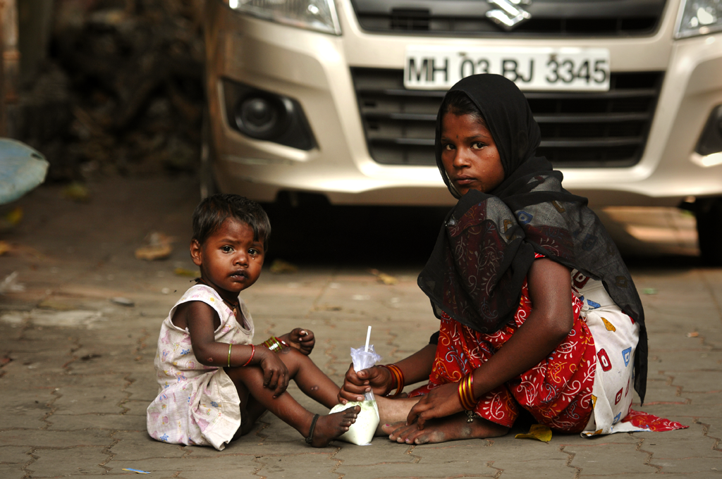 Photo of two Indian street children in Mumbai, India.