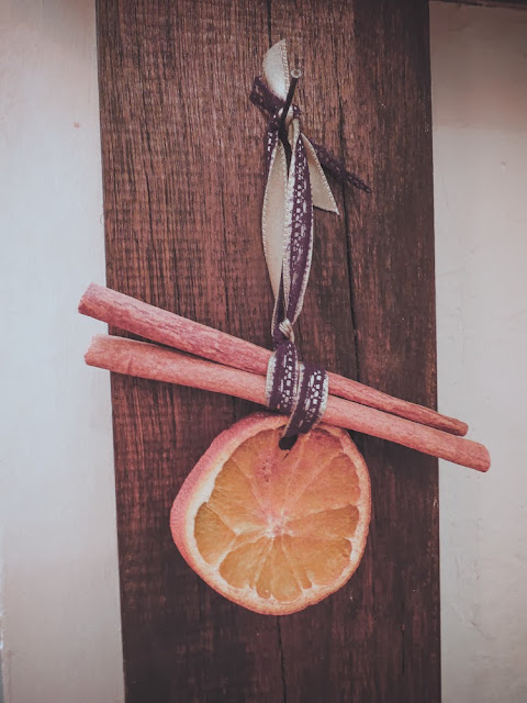 Orange and cinnamon stick decorations