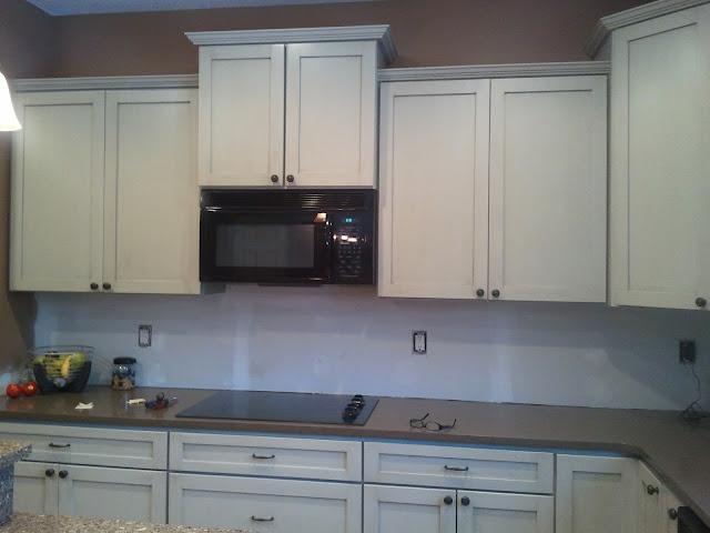 Aged maple kitchen cabinets converted with enameled glazed finish