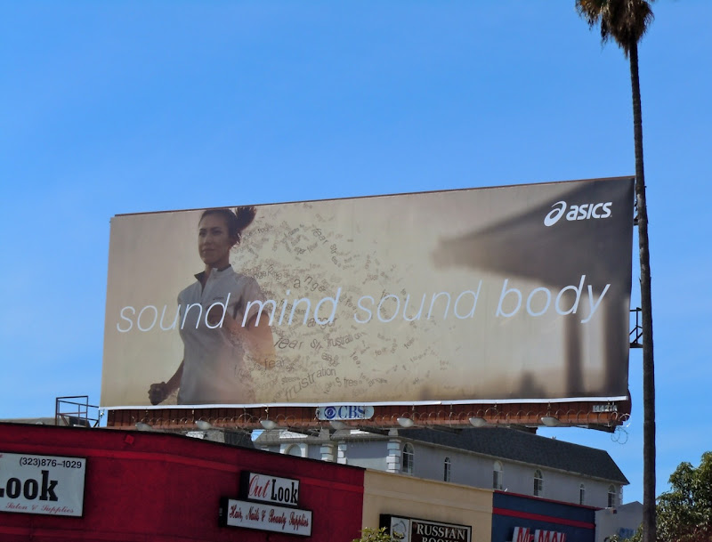 Asics female runner billboard