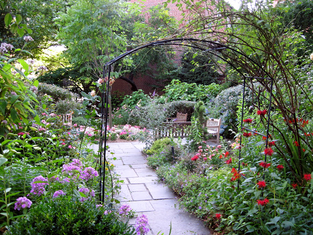The Arch welcomes visitors to this special Old New York garden, The Gardens At Saint Luke in the Fields