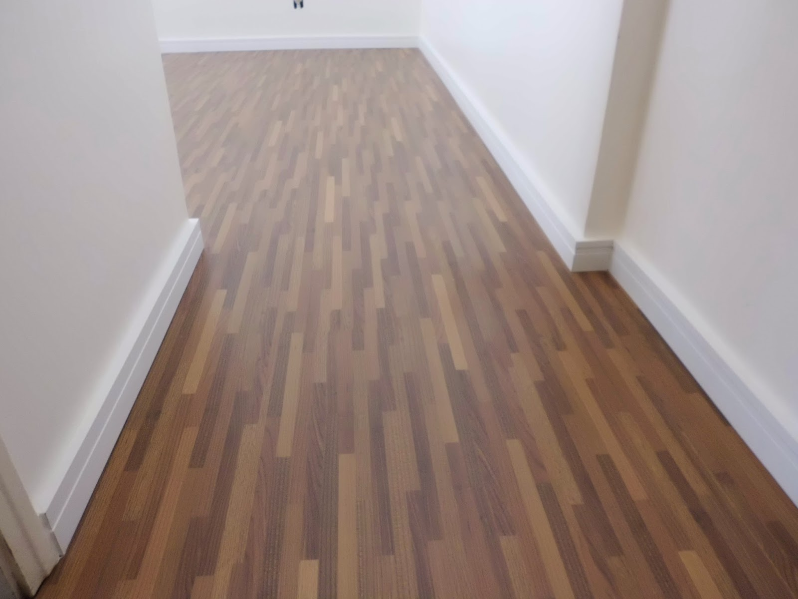 Pisos de madeira piso laminado cumaru palito instalado for Piso laminado instalado
