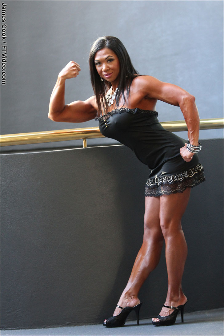 Janet Rosa Flexing Her Bicep In A Black Dress