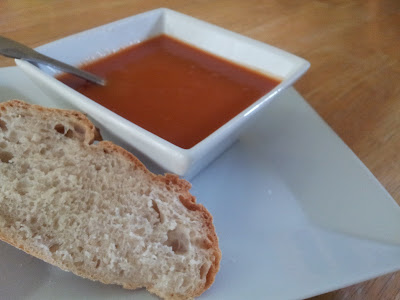 Bowl of tomato soup made with Dell' Alpe extra virgin olive oil and pear tomatoes
