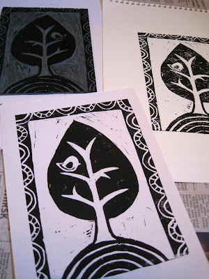 Bird in a tree lino prints.