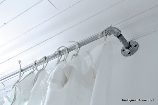 Galvanized pipe and sheet curtains via Funky Junk Interiors