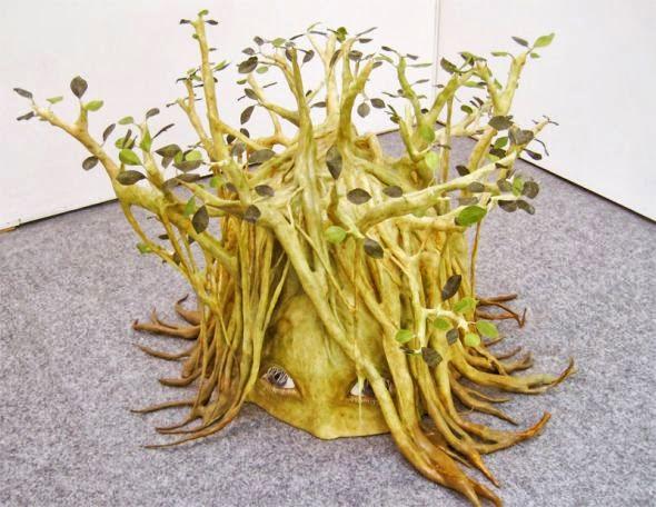Yui Ishibari esculturas surreais perturbadoras crianças tomadas por plantas natureza bizarra