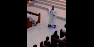 Hoverboarding priest gets suspended by church