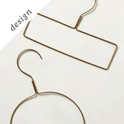Display-Worthy Clothes Hangers | Remodelista