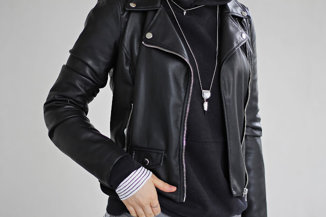 layered necklace and black hoodie