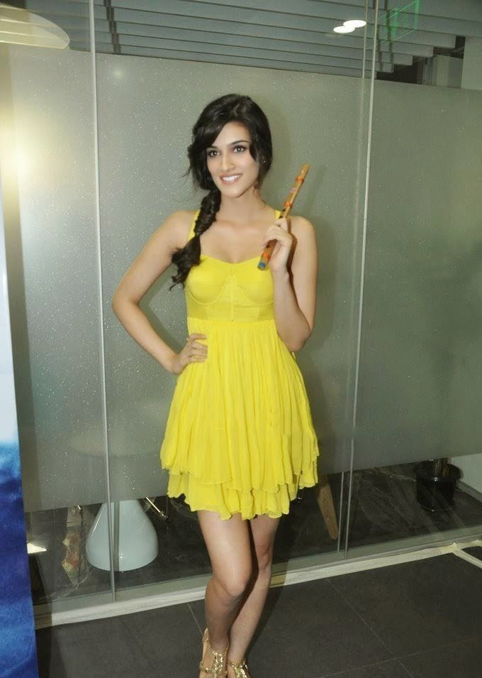 Kriti Sanon Exposing her juicy milky sexy thighs in yellow mini skirt hot upskirts pics of sexy actress kriti sanon